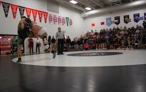Trojan Wrestling Places Fourth at John J. Harris