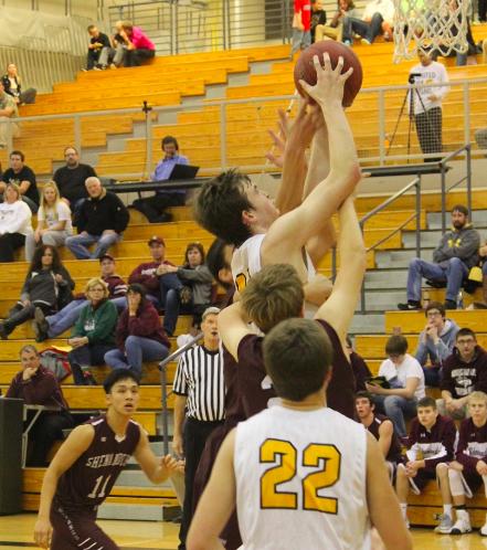 Senior Garrett Franken goes up for a rebound over Mustang defenders.