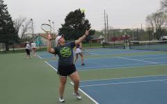Trojan Tennis Plays Denison Monarchs