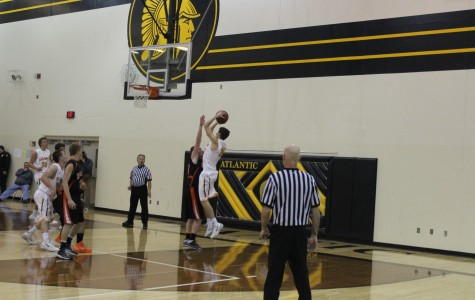 Trojans Dominate Tigers in Home Opener