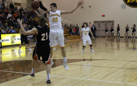 Tigers Oust the Trojans
