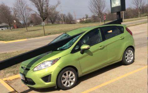 Light Pole Flattens Teacher's Car