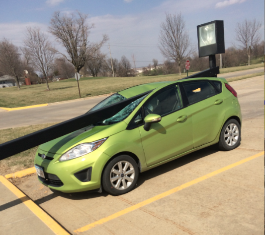 A teacher's 2013 Ford Fiesta was damaged by a falling light pole in the AHS parking lot on Wednesday. Photo by AHS journalist Brecklyn Carey.