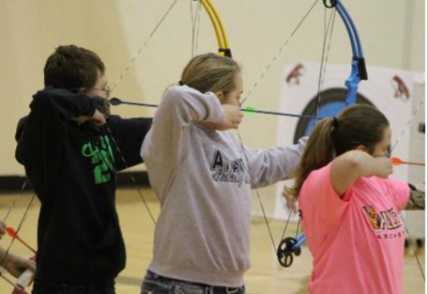Nathan Gray and Heather Freund site in alongside their competition at a home archery meet last year.