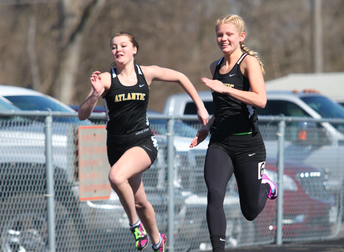 Sophomores Shelby Pelzer and Mariah Cook run in the 100 meter dash. Pelzer placed 8th.