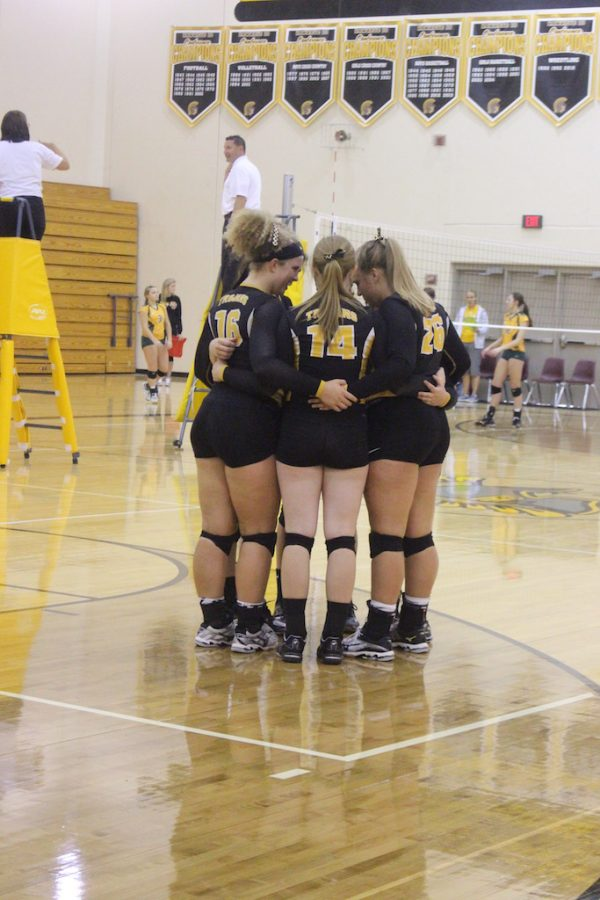 Trojans huddle up at a home tournament on Sept. 10.