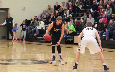 Trojan Basketball Earns First Season Win Against the Huskies