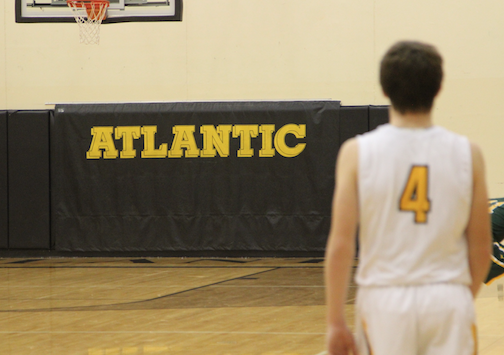 TROJAN POWER - Sophomore Chase Mullinex walks down the court after an Atlantic score. The Trojans now have a record of 2-0.