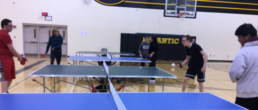 DID SOMEBODY SAY PING PONG?- Students in eighth-period gym class enjoy a game of ping pong.  The eighth period class was taught by Ryan Henderson.  Ping Pong is one of the many different sections of sports and games played in gym class.