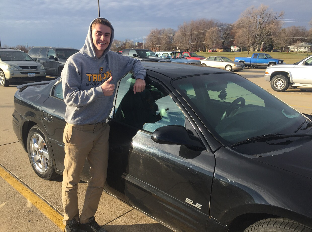 Junior Dillon Sonntag poses next to his Pontiac Grand Prix. Sonntag bought the car at the beginning of his junior year. He loved the car as soon as he laid his eyes on it.