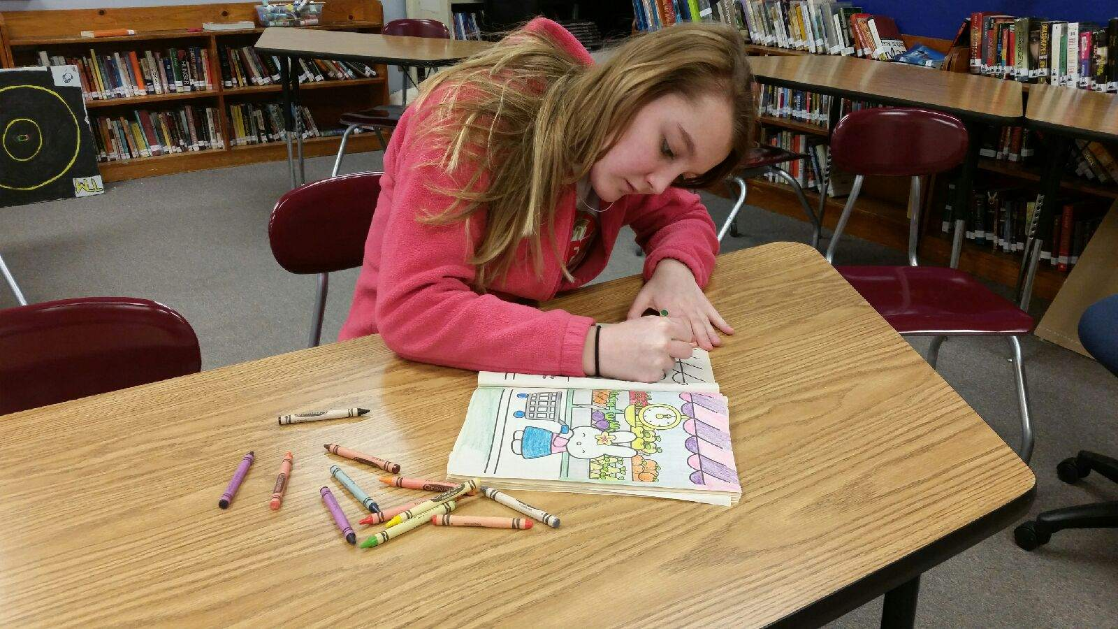 TRYING TO FOCUS-Junior Mariah Cook colors to help her relieve her stress.
