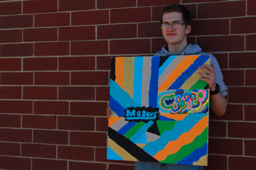 JP Student Marcus Duranceau with his ceiling tile.