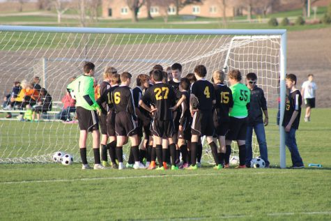 The Trojan huddle, before every game the boys talk about how they are going to play the game.