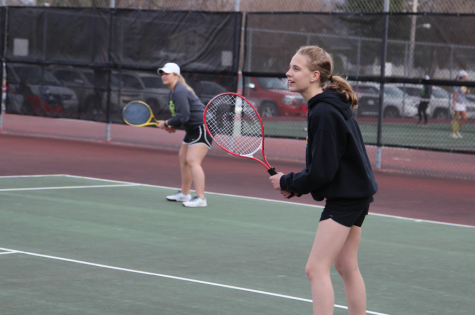 Trojan Tennis Takes on the Knights