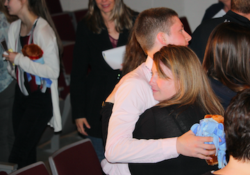Junior Jaxson Eden hugs his mother Cynthia Andersen at the conclusion of the Every 15 Minutes experience.