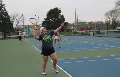 Trojan Tennis Plays Denison Monarchs