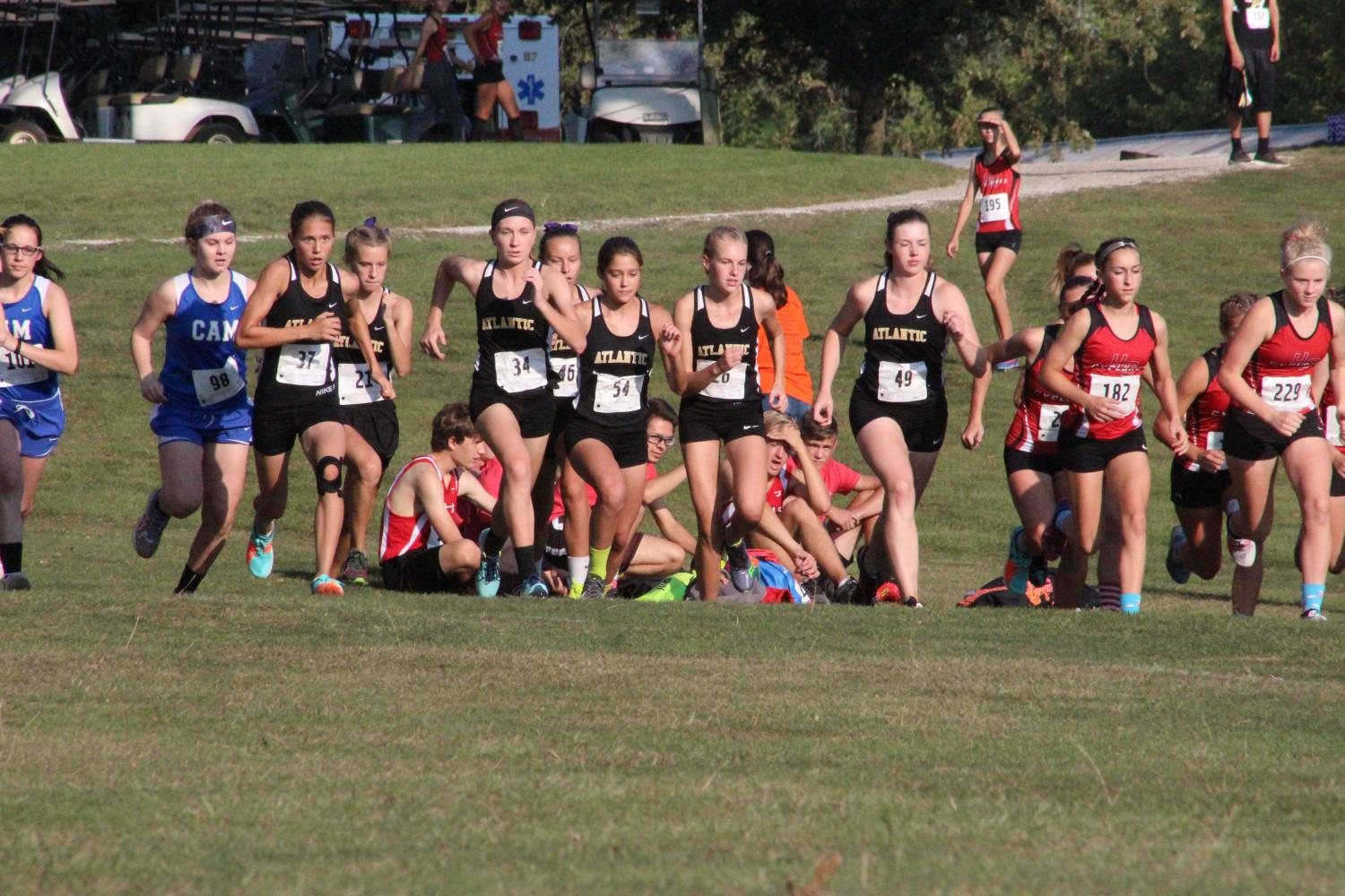 AND THEY'RE OFF- The girls varsity team takes off to begin their race.  The girls finished second on Saturday in Harlan.