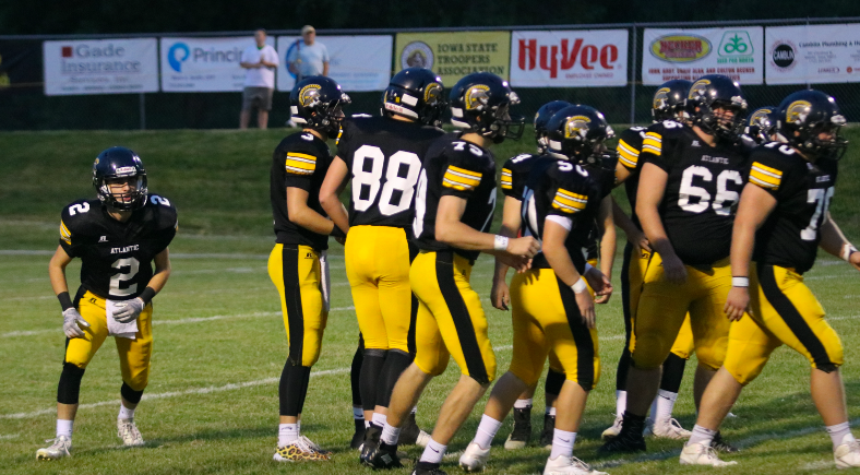 READY%2C+BREAK-+The+Trojan+offense+breaks+the+huddle+to+get+set+for+the+play.+Photo+Credit%3A+Taylor+Hansen