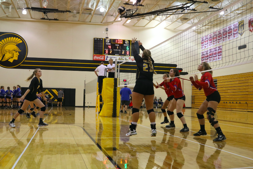 SET+ME+UP-+Senior+Sidney+Svoboda+sets+the+ball+to+sophomore+Chloe+Davis+for+the+kill.+Photo+Credit%3A+Hannah+Alff