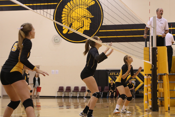 The volleyball girls prepare to block the return of an opponent last season.