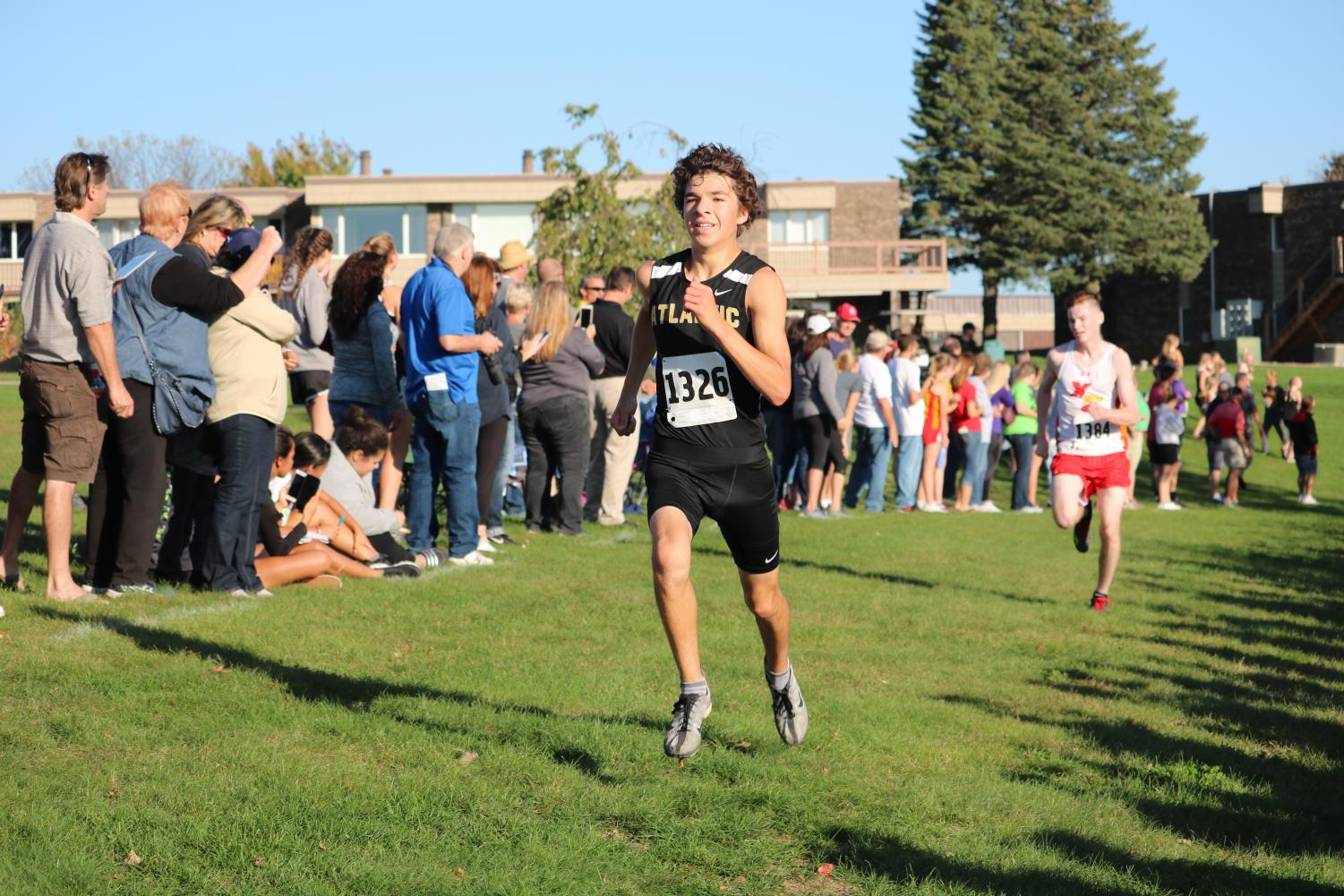 Junior Jalen Petersen sprints to the finish at the end of his race.