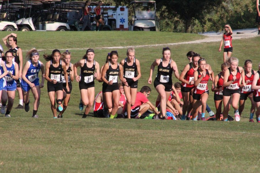 The varsity girls take off after the starting gun shoots at the Red Oak meet earlier this season. The girls placed second at the meet.