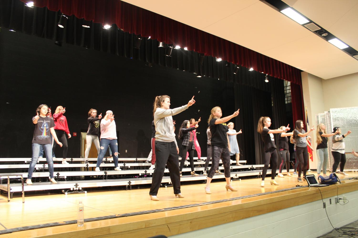 SHOW OFF- Show choir practices their dancing. they will be attending multiple competitions this year.