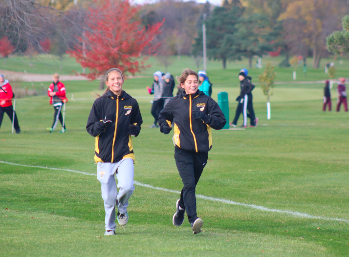 Freshman Taylor Mccreedy and junior Ashley Wendt warm up at the state meet.