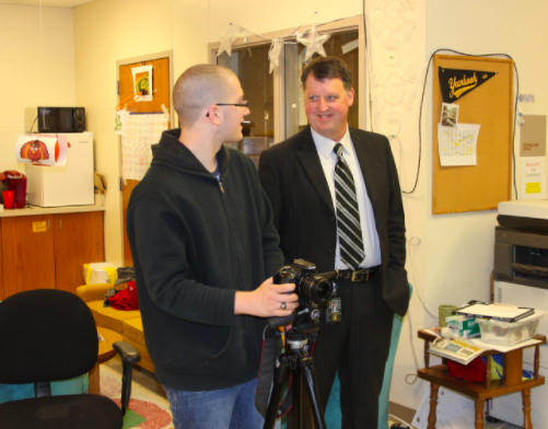 COMMUNICATION- Superintendent Steve Barber talks with journalist Marcus Duranceau. Baber has been active in communicating with staff and students in the district. He has also been seen at many athletics practices and games.