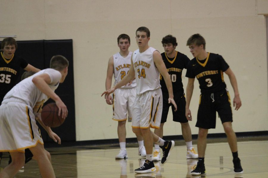Senior Grant Podajsky and Junior Logan Reilly look towards the ball in the first game of the season against Winterset.