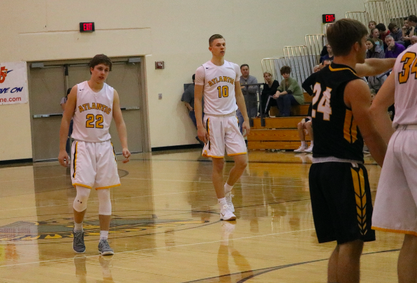 Seniors Jaxson Eden and Austin Alexander await the free throw.