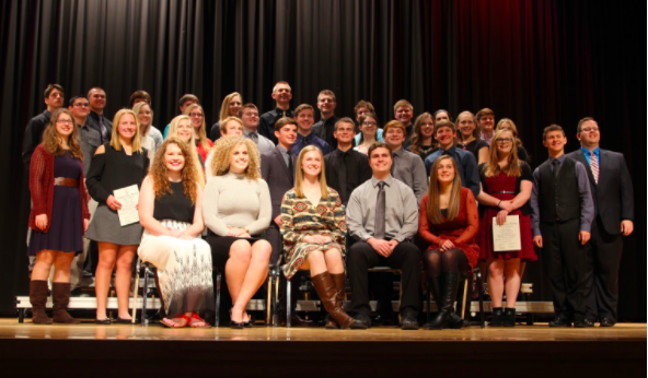 ALL SMILES - The 2017 National Honor Society inductees join with the 2016 members to pose for a picture. The new recruits were escorted in by previously accepted individuals and handed their certificates before taking a quick snapshot.