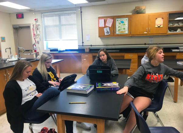 Sophomores Corri Pelzer, Chloe Davis, Pluma Pross, and Kelsie Siedlik work in Miss Williams Biology class.