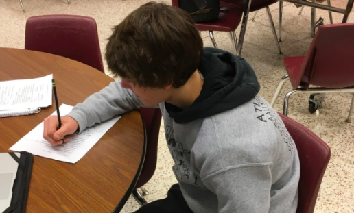 STUDY UP- Freshman Joe Weaver works in study hall. Students use these times to study and get other homework done for their classes.