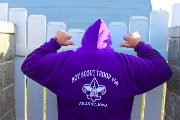 Sophomore Lucas Behrens poses in his Atlantic Boy Scouts Troop #54 hoodie. Photo by Dylan Litty