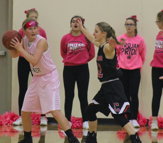 Junior Baylee Newell looks for a teammate to help her out of a sticky situation.