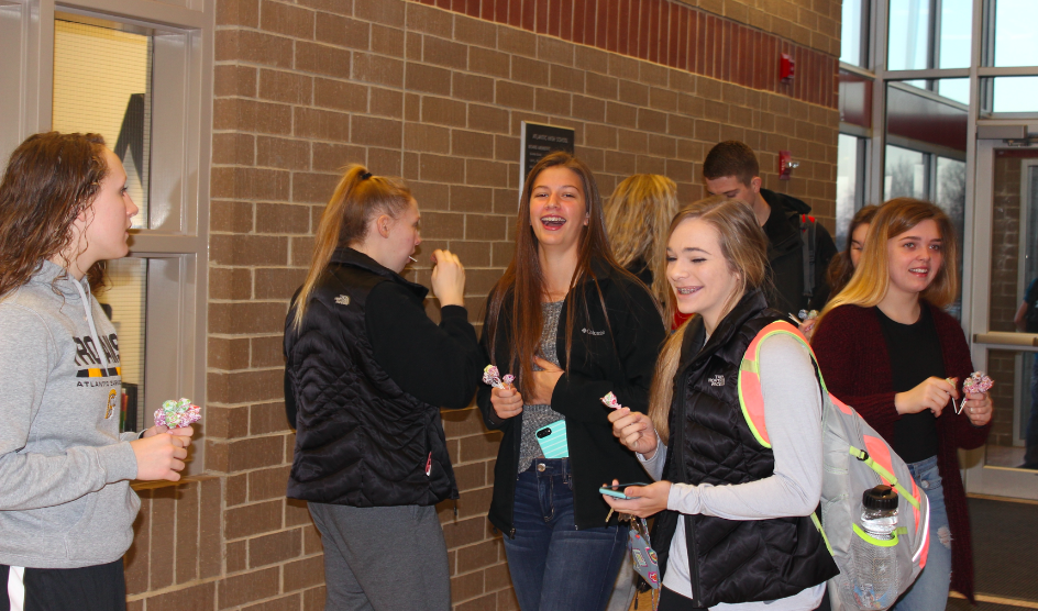 AHS Fuel members greet students on Friday morning.