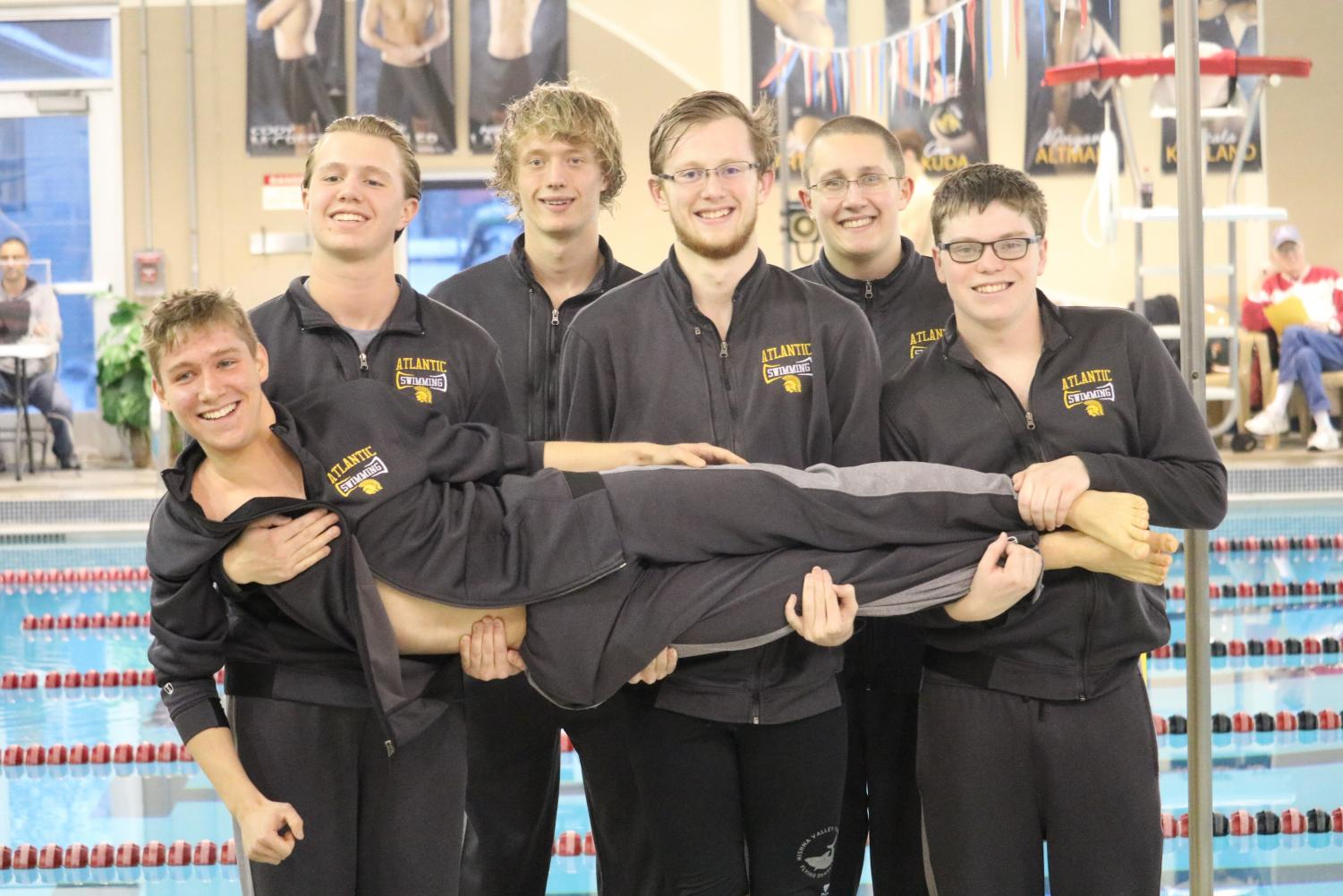 Members of the boys swim team have some fun at their home meet. The meet was held at the YMCA.