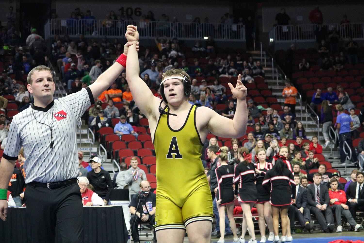 HEART OF A CHAMPION - Senior John McConkey gets his hand raised to signal he has won the State title. McConkey won his match with a final score of 7-6 against Spencer Trenary of Clarion-Goldfield-Dows.
