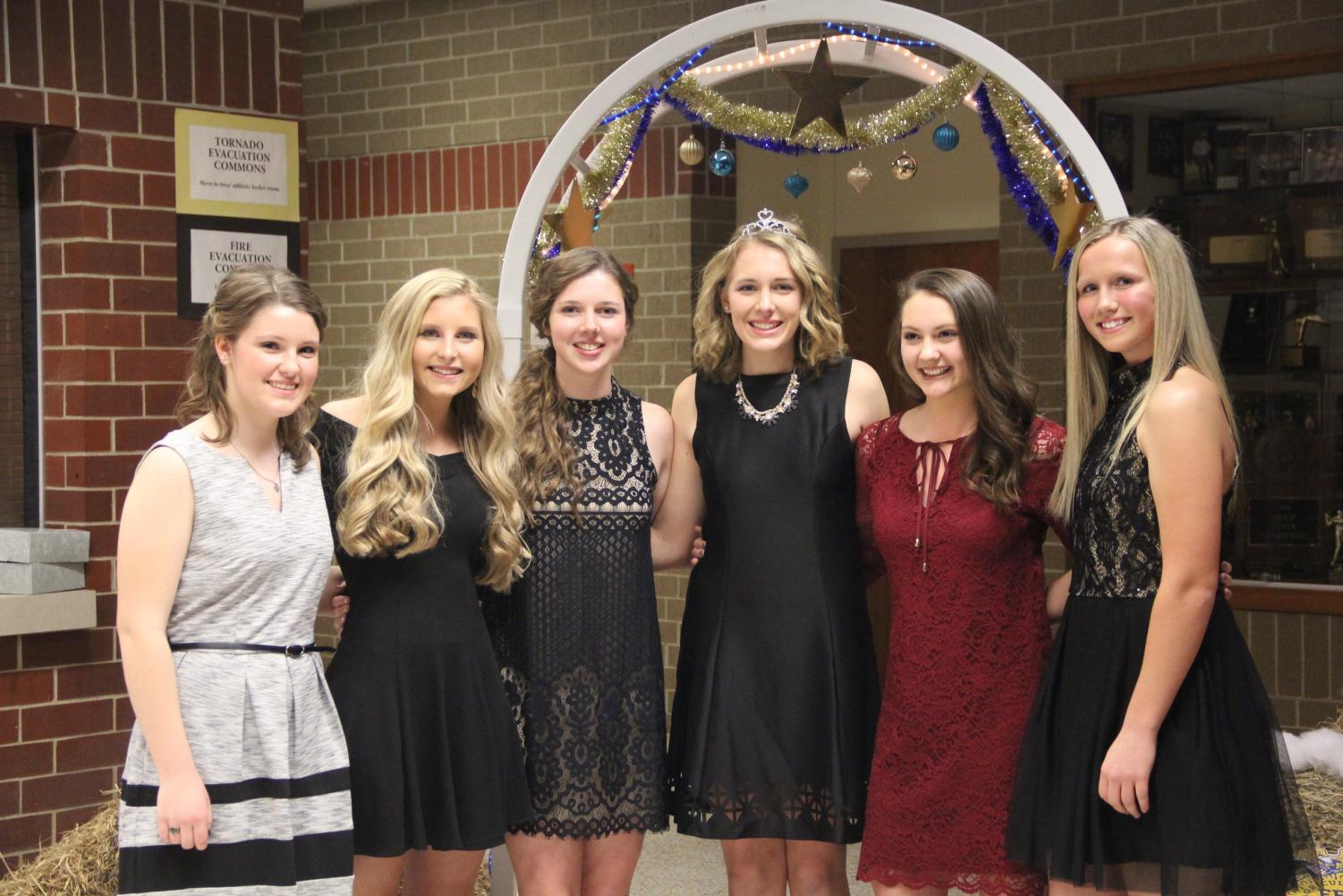 SAY CHEESE - Members of the 2017 Winter Formal court pose after the crowning of the queen. The court consisted of Nicole Eilts, Kirsten Brown, Emily Saeugling, Heather Freund, Chloe Newbury, and Ally Anderson.