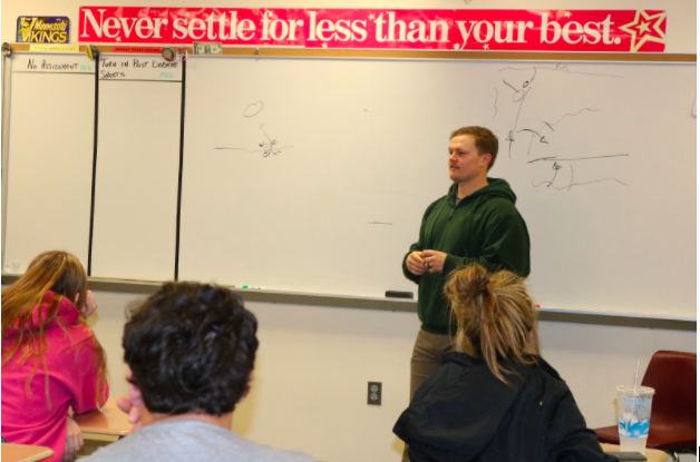 2006 AHS graduate Nathan Allen speaks to Terry Hinzmann's class about his experiences in Afghanistan.