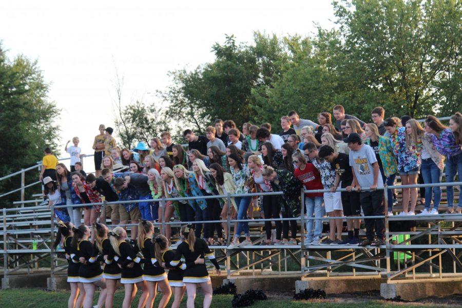 Cheerleaders lead the crowd in