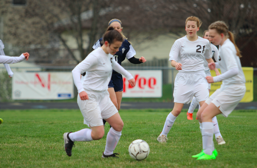 I'VE GOT IT - Sophomores Kayla Mauk and Callie Richter and junior Sadie Welter attack the ball during a JV game in the 2017 season. This game was against Lewis Central at home. Mauk, Richter and Welter will all be returning for the 2018 season.