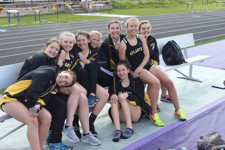 SAY CHEESE - Members of girls' track grin for a picture at the 2017 Denison meet. Times have been improving in many events this season.