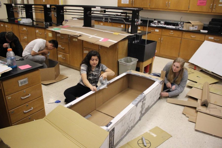 Junior+Yara+Haidar+and+senior+Paige+Bennett+work+to+build+their+boat.+They+were+given+three+days+in+class+to+work+on+these+and+whatever+doesn%27t+get+finished+will+have+to+be+done+on+their+own+time.