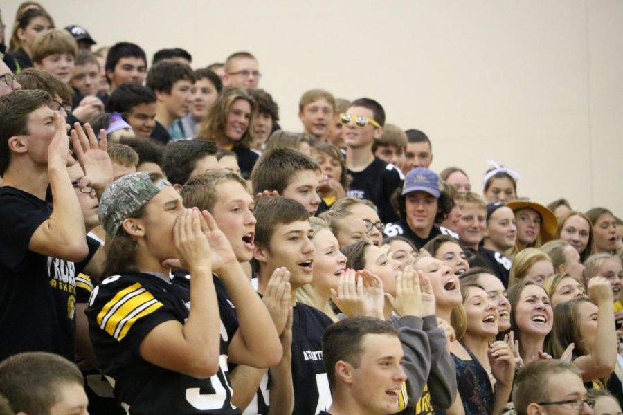 PUMP+IT+UP+-+Students+cheer+in+the+auditorium+at+a+pep+rally.+The+Trojans+played+Creston+for+the+2017+homecoming+game%2C+winning+in+overtime.