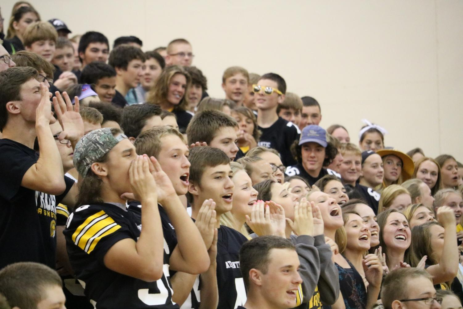 PUMP IT UP - Students cheer in the auditorium at a pep rally. The Trojans played Creston for the 2017 homecoming game, winning in overtime.