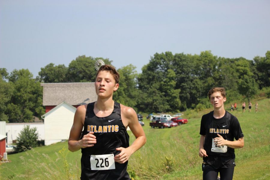 STICK TOGETHER - Senior Alvin Nantz and junior Zach McKay race near each other at the Glenwood meet. This was the first meet of the season, held on Aug. 25.