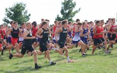 Trojan Runners Make the Most of the Mud