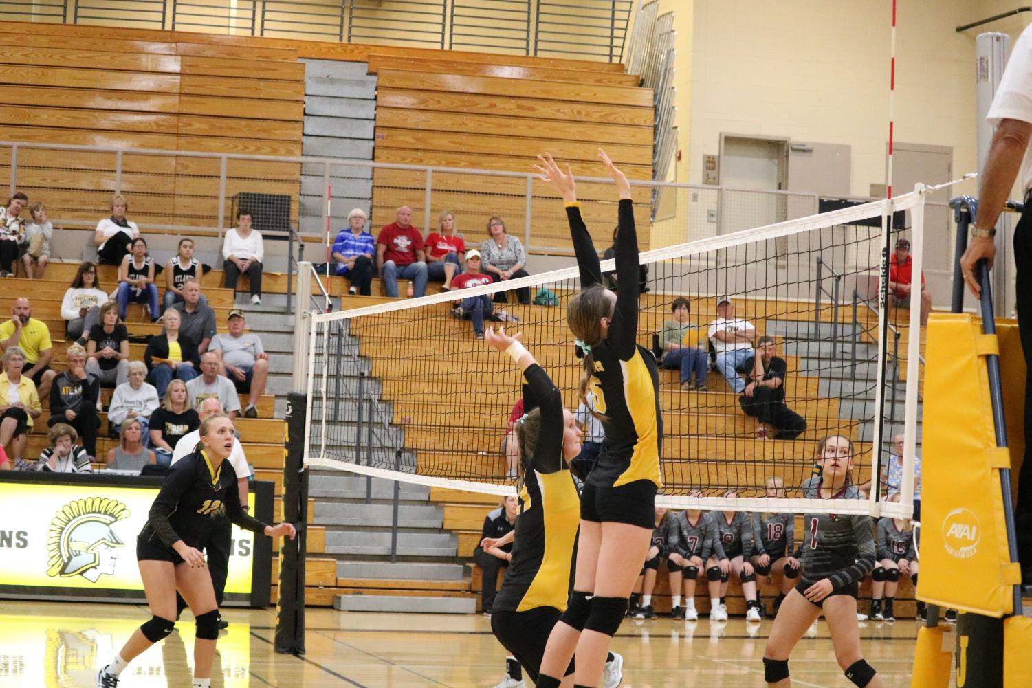 Freshmen Lexie Trotter and Reagan Leonard go up for the block against Clarinda on Monday night.